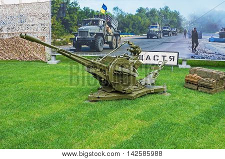 Dnepropetrovsk Ukraine - May 19 2016: Open air museum dedicated to war in the Donbass. Double-barreled anti-aircraft gun and boxes of ammunition