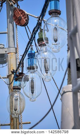 Shipboard lamps hanging over the deck of the boat