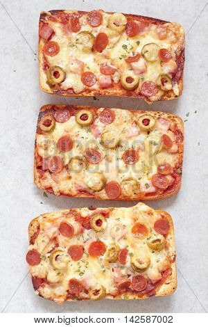 Ciabatta pizza with mini pepperoni and green olives