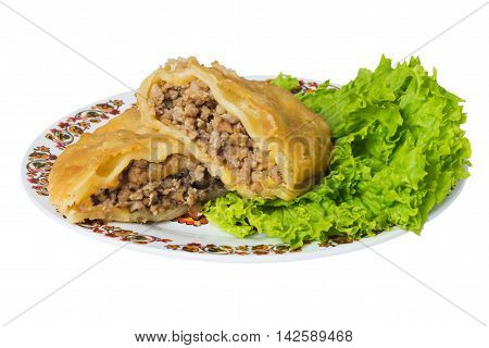 Caucasian pie stuffed with meat (cheburek) on plate isolated