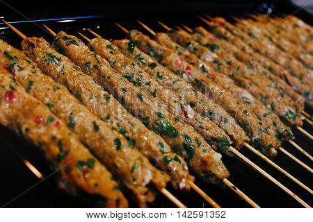Rows of juicy beef kebab koobideh on grill poster