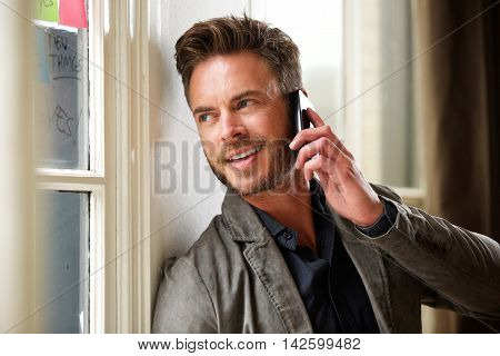 Middle Age Professional Man On Telephone Call
