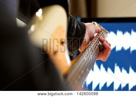 Man Playing Chord On Electric Guitar