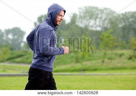 Athletic Middle Age Man Running Park