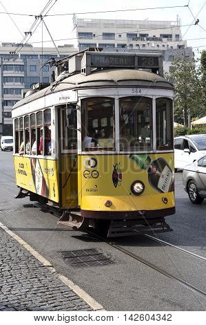 LISBON, PORTUGAL - September 25, 2015: Old style tram operating on the famous route 28 on September 25, 2015 in Lisbon, Portugal