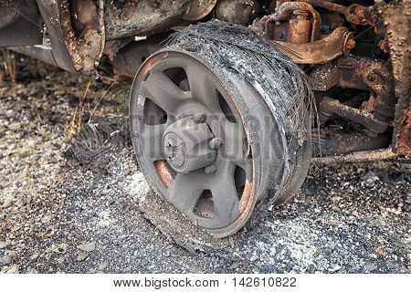 Close Up Of The Remains Of A Car Wheel After It Was Burnt.