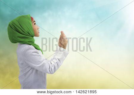 Young Muslim Asian Woman Praying To God