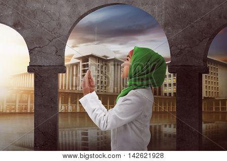 Young Asian Muslim Woman Praying To God