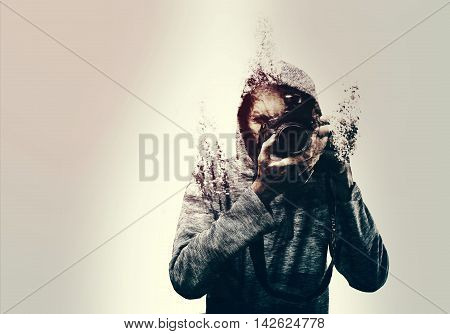 Abstract self portrait of a photographer holding a DSLR camera shattered into pieces. isolated