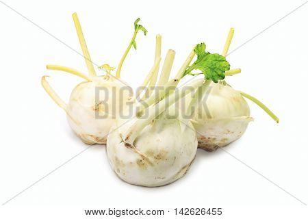Three kohlrabi isolated on a white background
