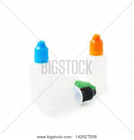 Bunch of plastic 30 ml bottles isolated over the white background