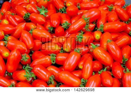 cherry tomatoes: A cherry tomato is a rounded small fruited tomato thought to be an intermediate genetic admixture between wild currant-type tomatoes and domesticated garden tomatoes