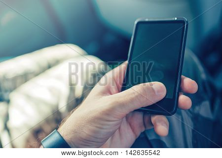 Playing with mobile phone instead of his child bad role model father using smartphone while his son asks him to do something else