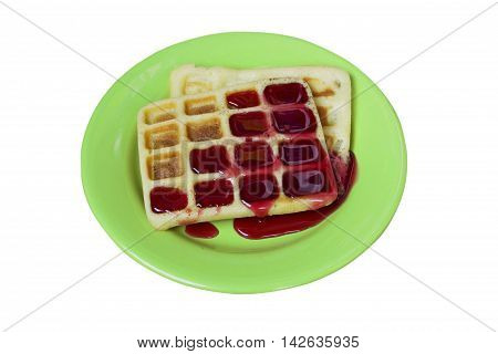 Viennese waffles with sweet jam on a plate - isolated on a white background.