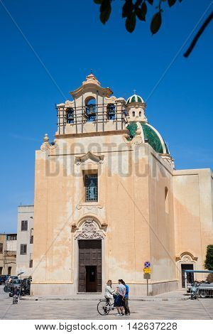 Favignana Sicily - 2016 April 16 : The church of the Immaculate Conception in the center of the town of Favignana on the island with the same name with some people in front