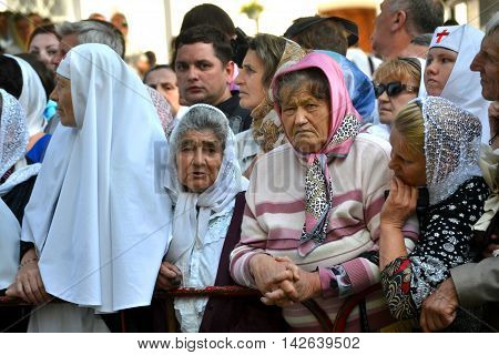 Kiev Ukraine celebration liturgy in honor of the baptism of Rus in Kiev Pechersk Lavra - 27 July 2013 -: Mature old woman standing in the crowd look at the camera