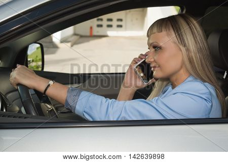 Business Woman On Phone In Automobile