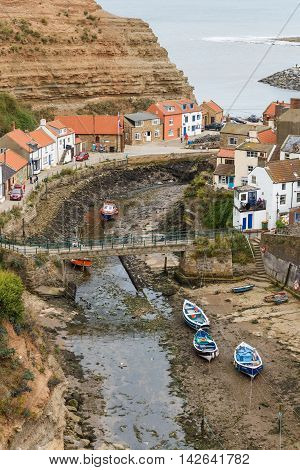 STAITHES ENGLAND - AUGUST 12: High view looking down onto Staithes Beck and the town. In Staithes North Yorkshire England. On 12th August 2016.