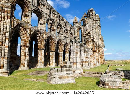 WHITBY ENGLAND - AUGUST 12: Tourist visiting the ruins of Whitby Abbey. In Whitby North Yorkshire England. On 12th August 2016