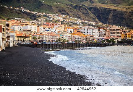 the seafront in a small town Candelaria with its black sand beach Tenerife Canary Islands Spain