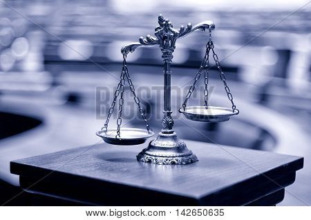 Symbol of law and justice in the empty courtroom law and justice concept.
