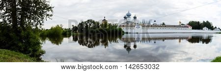 Panorama of Tikhvin assumption male monastery and Tikhvin icon of the mother of God. The Orthodox Church of Russia. The temple on the banks of the Tikhvinka river in Tikhvin.