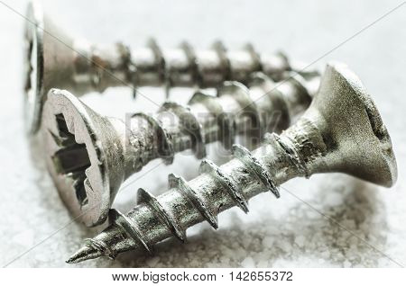 a three metal screws macro close up