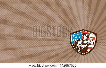 Business card showing illustration of a welder rod-holder with cable and electrode for electric arc welding and welder visor mask looking to the side with usa american stars and stripes flag in the background set inside shield crest done in retro style.