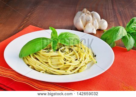 Italian pasta spaghetti with pesto sauce and basil leaf. Spaghetti al pesto.