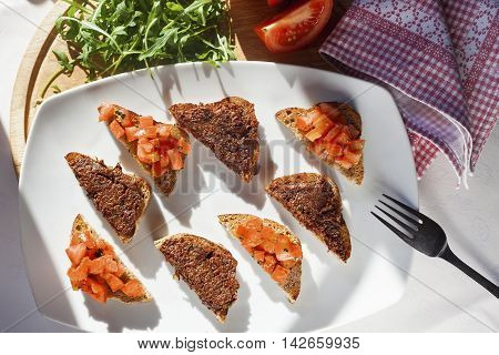 Brochette with tomato and olives, top view