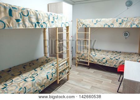 The hostel interior - bedroom. double bed. beautiful interior