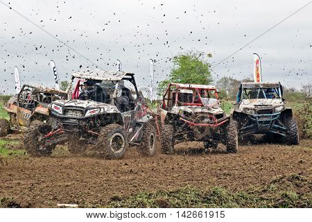 HYDE, UK - APRIL 6: Drivers competing in the NoraSXS UK champs approach the first corner at speed causing a bottleneck for the following field during Rd 1 of the 2014 season on April 6, 2014 in Hyde