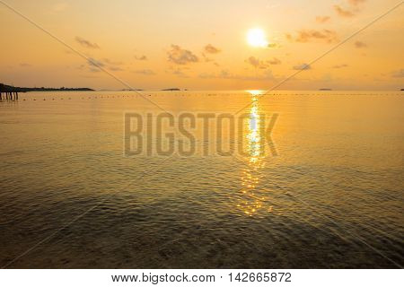 Tranquil seascape of calm sea during sunrise in dawn at Ao Lung Dam beach in Samet island Thailand.
