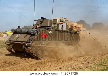 WESTERNHANGER, UK - JULY 18: An ex M113 Bradley armoured troop carrier is driven around the main arena for the public to watch at the W&P show on July 18, 2014 in Westernhanger
