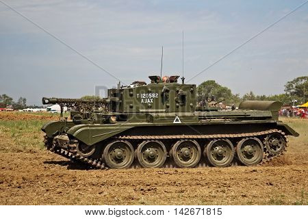 WESTERNHANGER, UK - JULY 18: A vintage WW2 ex British army Comet tank gives a display to the watching public at the War & Peace show on July 18, 2014 in Westernhanger