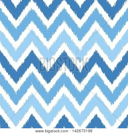 Seamless geometric pattern, based on ikat fabric style. Vector illustration. Blue chevron pattern. Blue zig-zag seamless pattern.