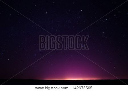 Natural Real Night Starry Sky Stars Background And Night City Lights. Natural Background With Black Sky And Many Stars