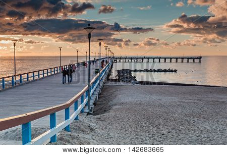 Colorful sunset at a famous marine pier in the Baltic resort city of Palanga, Lithuania, Europe