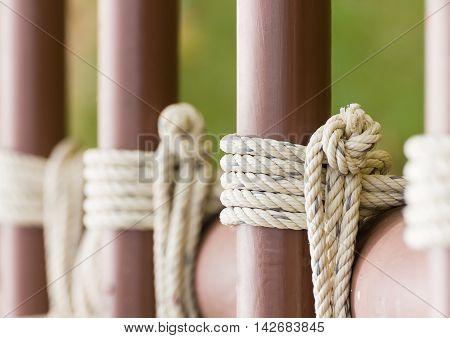 Rope Knot Around A Metal Fence