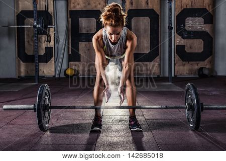 Girl getting ready for  training in gym