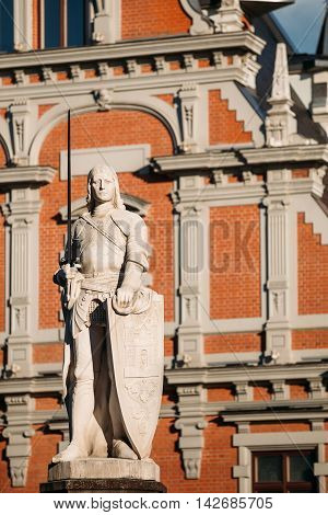 Statue Of Roland At The Town Hall Square On The Background Of The House Of Blackheads In Riga, Latvia. Sunny Summer Day With Blue Sky. Famous Landmark. Old Architecture. Travel Destination poster