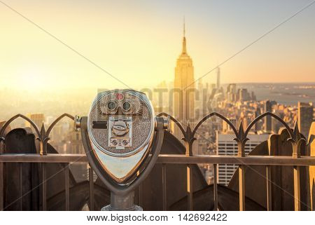 Tourist binoculars overlooking the Manhattan skyline in New York City at the morning, USA, United States of America