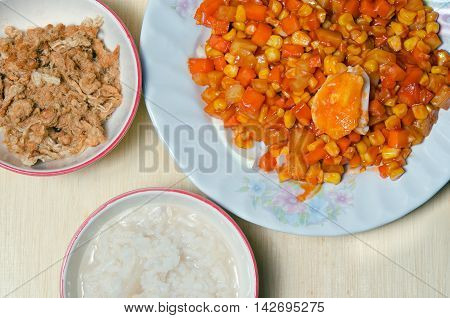 Bowl Of Rice Porridge With Shredded Pork Or Pork Floss And Salted Egg Mixed With Vegetables