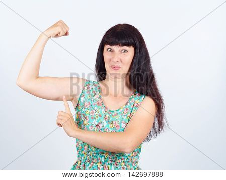 Funny Young Woman Showing Biceps.