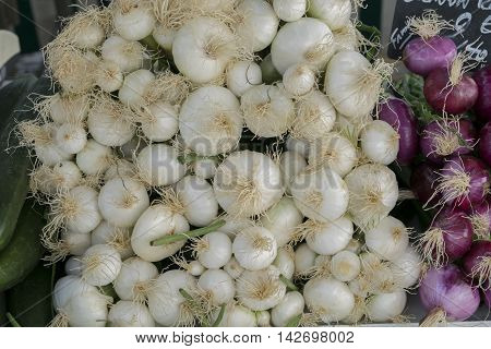 Onions sold as is on a rural market.