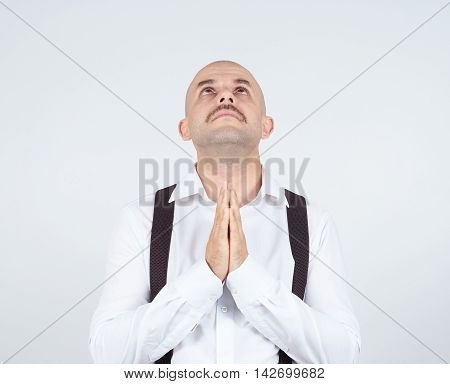 Bald Man Praying,imploring, Hands Clasped Hoping Of Miracle