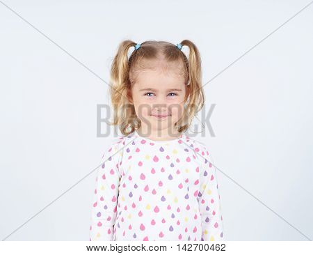 Portrait Of A Cheerful Little Girl.