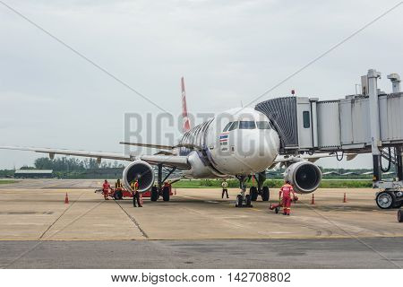 SURAT THANI THAILAND - MAY 30: Air Asia plane lands at Surat Thani airport on May 30 2016 in Surat Thani Thailand.