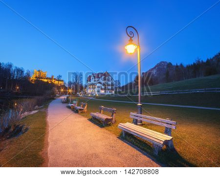 Beautiful benches with street lamp at night in Germany.
