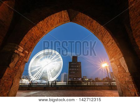 Ferris wheel in the Gdansk view from under the arch.